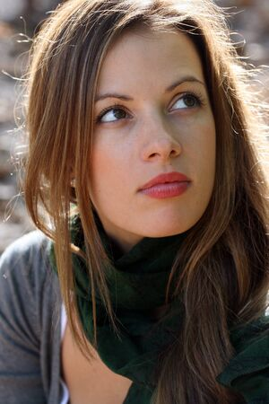 Portrait of young brunette woman in green scarf. Stock Photo - 15631449