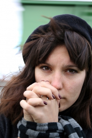Depressed woman with captive hands.