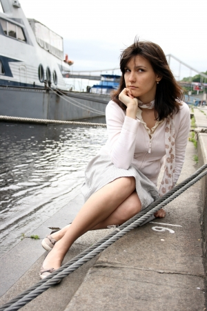 absorbed: Beautiful young woman on the pier.