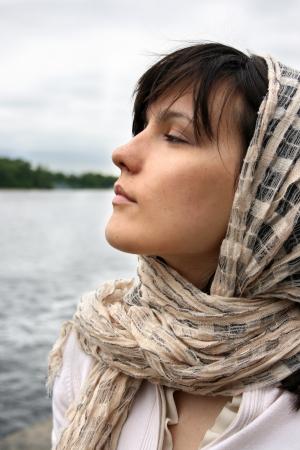 brune: Woman in kerchief on her head. Retro style.