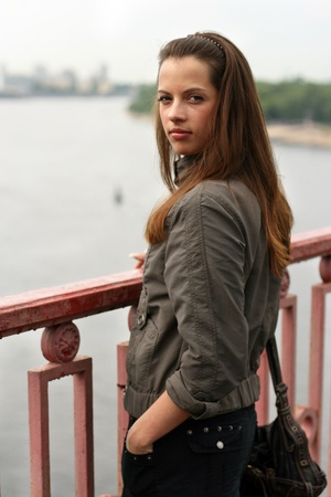 Woman on the brige in autumn time. Stock Photo - 16380388