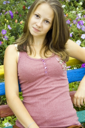 Portrait of a beautiful teenage girl in flowering garden.
