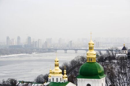 The view on Kiev Pechersk Lavra in winter time, Kyiv landscape. photo