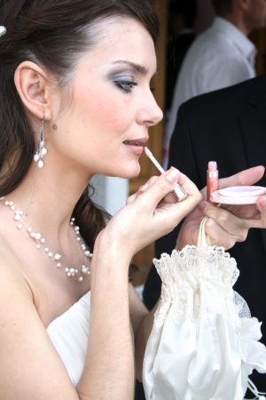Bride getting her makeup done. photo