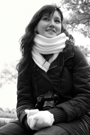 Portrait of young smiling woman in scarf.   photo