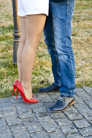Couple kissing, view of legs only. Stock Photo