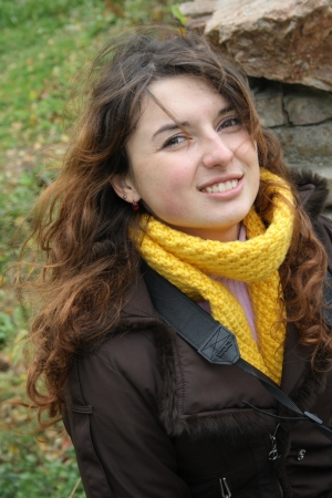 Beautiful brunette woman in yellow scarf  Autumn
