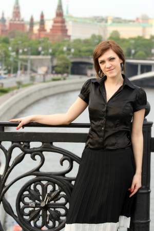 brune: Attractive elegant woman posing outdoors. View of Moscow in the background.