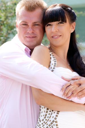 brune: Bride and groom on their wedding day hugging