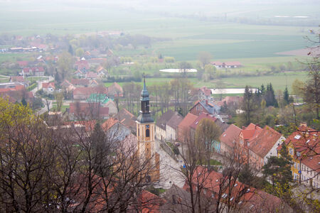View of the Polish town in the fog. Stock Photo