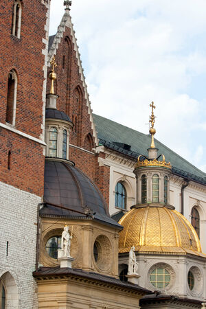 Golden domes of the Wawel Castle on the blue sky background. Krakow, Poland. Stock Photo