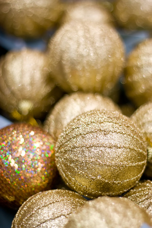 Golden Christmas balls in box. New Year decor.
