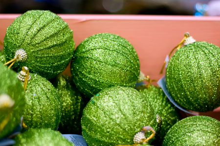 Green Christmas balls in box. New Year decor. Stock Photo