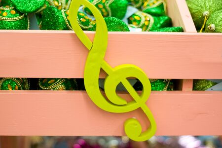 Lime green hand made wooden treble clef.