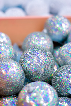 Silver Christmas balls in box. New Year decor.