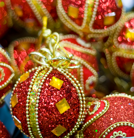 Red Christmas balls in box. New Year decor.