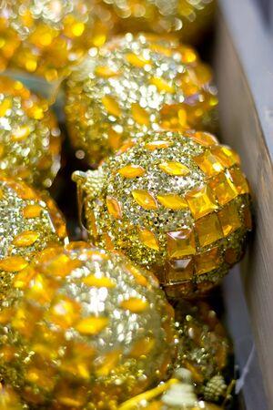 Golden Christmas balls in box. New Year decor.