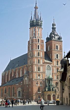 Tourists walking  near St. Marys Basilica in Krakow, Poland