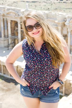 Beautiful blonde woman in sunglasses in Hierapolis, Turkey
