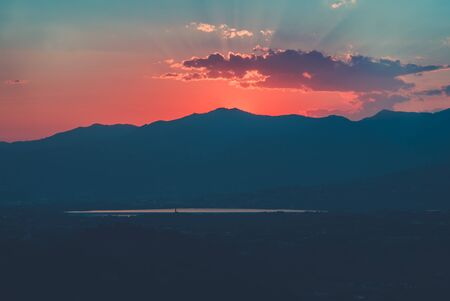 time lapse: Sunset over mountains Stock Photo