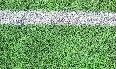 White  line cross in soccer field photo