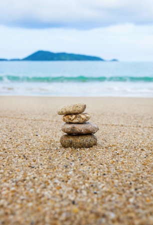 Stack of sea pebbles on the beach photo