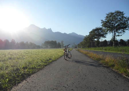 Sunshine on the Bicycle and switzerland summer view background photo