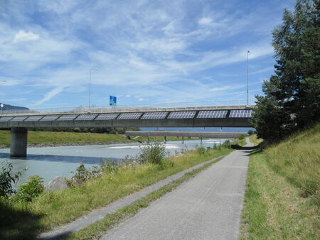 Solar panels on one of the border bridge Switzerland and Liechtenstein with blue sky and Rhine River photo