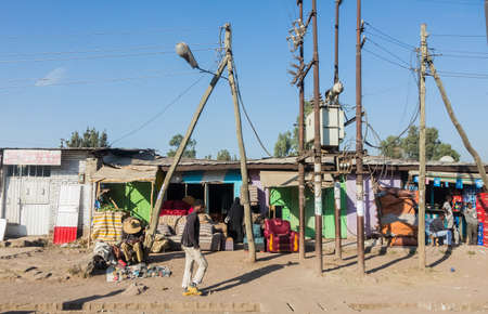 Addis Ababa, Ethiopia, January 30, 2014, Small shops on a dirt road with a few informal traders nearby