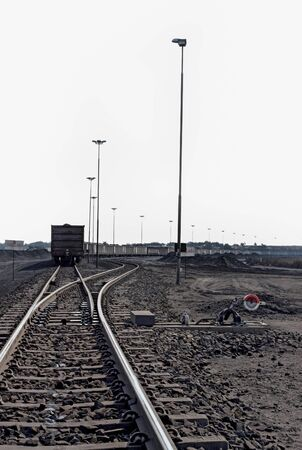 processed coal next to a rail siding waiting to be put on a train for transporting to a coastal port 版權商用圖片