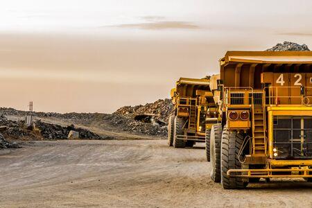 Mining dump trucks transporting Platinum ore for processing Stock fotó