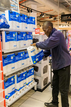Cape Town, South Africa - March 23, 2020: Grocery store staff packing shelves at Pick 'n Pay grocery store during virus outbreak