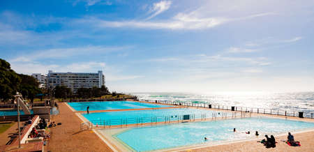 Cape Town, South Africa - October 15, 2019: View of Pavilion Public Swimming Pool on Sea Point promenade in Cape Town South Africa