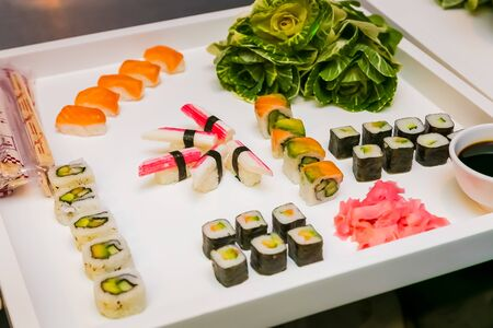White square Waiter Tray of fresh sushi for catering at a gala event or party