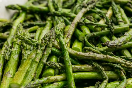Large bowl of freshly cooked asparagus for catering at a corporate event gala dinner banquet