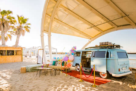Cape Town, South Africa - October 13, 2019: Photo Booth VW Kombi Van parked on white sand at Shimmy Beach Club at the V&A Waterfront Harbor