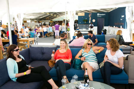 Johannesburg, South Africa - November 9 2013: Young female Friends eating, drinking and generally enjoying a day out at a Food and Wine Fair Editorial