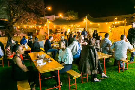 Johannesburg, South Africa - October 12 2017: Diverse Friends eating, drinking and generally enjoying a day out at a Food and Wine Fair