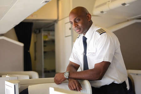 Johannesburg, South Africa - May 08 2012: British Airways Middle Aged Africam Male Captain Pilot