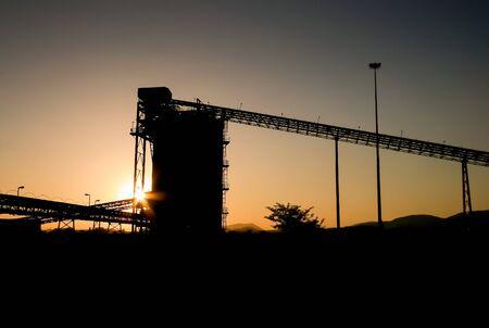 conveyor belt at sunset on platinum mine Reklamní fotografie