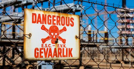 Danger Sign on a fence in English and Afrikaans language