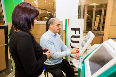 Johannesburg, South Africa - June 12 2013: Customer Assistance Inside of a photo printing lab