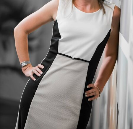 Cropped head Business Woman in corporate attire with hand on hip