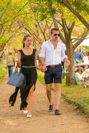 Johannesburg, South Africa, 05/10/2014,  Young couple walking hand in hand at The Winter Sculpture Fair at Nirox Sculpture Park