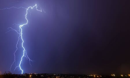 large lightning strike to ground during thunderstorm