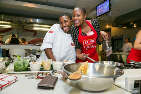 Johannesburg, South Africa - November 10, 2016: Diverse young people learning to cook and bake at a cooking class