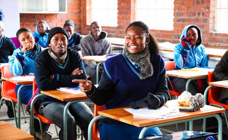 Johannesburg, South Africa - July 29 2011: African High School Children in Classroom Lesson Editorial