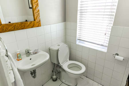 Cape Town, South Africa - February 6, 2020: Inside interior of empty bathroom and toilet in up-market house in the suburbs Editorial