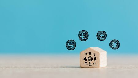 Real Estate and Housing Property Market Concept using Wooden House Model on Blue Background Banque d'images