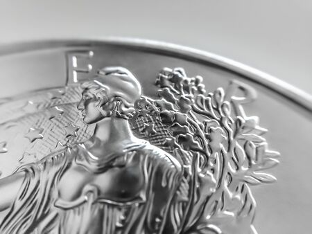 Macro Close up of a 999% Silver American Eagle Bullion Coin as Money Imagens